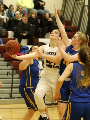 Gillian Clark of Odessa-Montour puts up a shot as she is defended by Tioga's Madeleine Teribury on Dec. 15 at O-M.