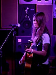Sarah Shook and The Disarmers are shown performing