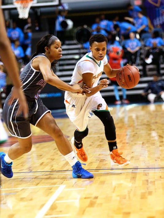 Andreya Lacy drives around a defender.jpg