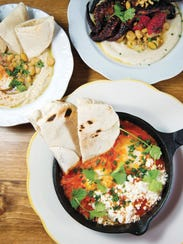 Foreground: Shakshuka, Background L to R: Old City