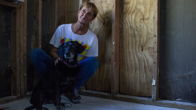 Baton Rouge resident and artist Rosemary Goodell sits in her at-home studio space with her dog, Jill, who would often keep her company while she worked.