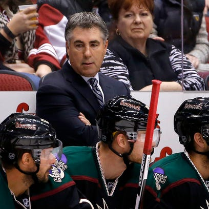 Arizona Coyotes coach Dave Tippett stands on the bench