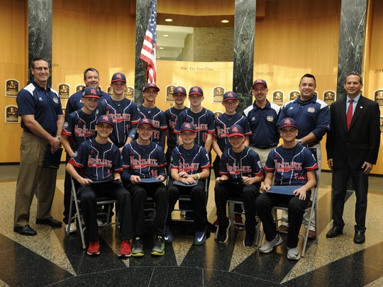 Below, players and coaches from the Maine-Endwell Little League World Series championship team pose with Baseball Hall of Fame President Jeff Idelson, right, in the Plaque Gallery, where each Hall of Fame member is commemorated.