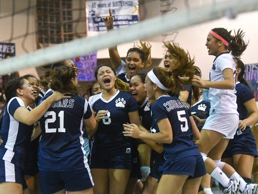 The Academy of Our Lady of Guam Cougars celebrate an