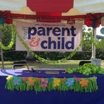At the SW FL Parent & Child booth at the Southwest Florida Reading Festival on March 21, children wrote their favorite book titles on papers that became a link in a growing paper chain. In the end, that chain measured about 60 feet and had 276 links.