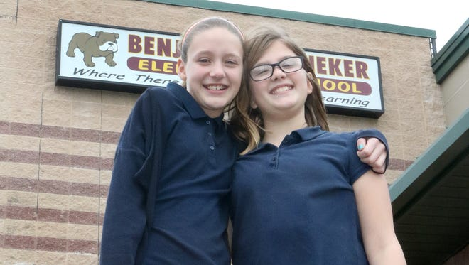 Milford fifth-graders Sabrina Kadow (left) and Kylie Moorman took their friendship to a new level recently when Kylie potentially saved Sabrina's life by dislodging a Lifesaver mint from her throat using the Heimlich maneuver.