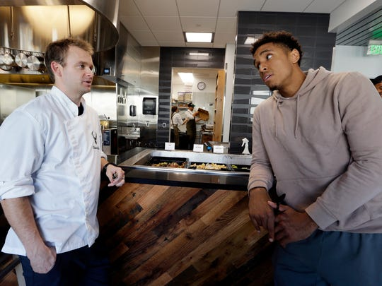 "The open kitchen allows for interaction between team chef/dietitian Shawn Zell and players such as Malcolm Brogdon. ""Malcolm's very involved,"" Zell said."