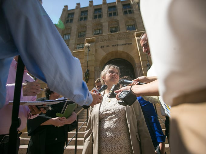 State Superintendent Diane Douglas leaves the Maricopa