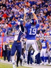 Myles White (19) goes up and makes the catch for the New York Giants in a 2015 game against New England.