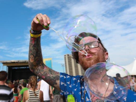Jacob Redmon of Monroe blows bubbles while listening