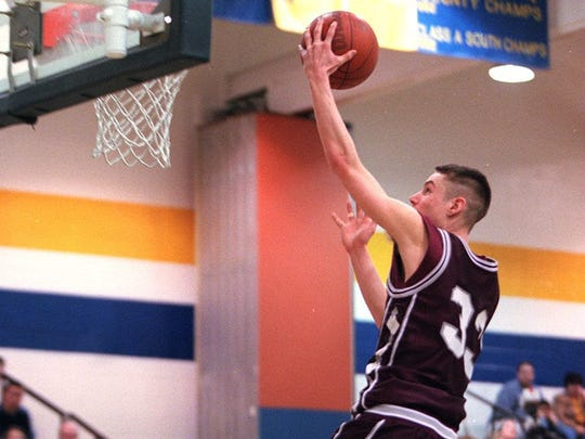 Toms River South's Charlie Frazier drives to the basket against Toms River North in 1998.