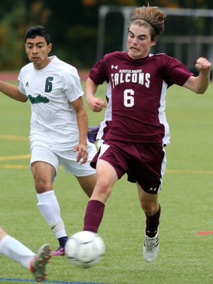 Pleasantville's Anthony Cardona, left, and Albertus Magnus' Joe Michalak battle for control of the ball during their Class B  first-round playoff game at Pleasantville High School Thursday. The Panthers defeated the Falcons 5-1.