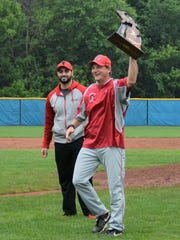 Clarenceville fifth-year coach Craig Cotter hoists