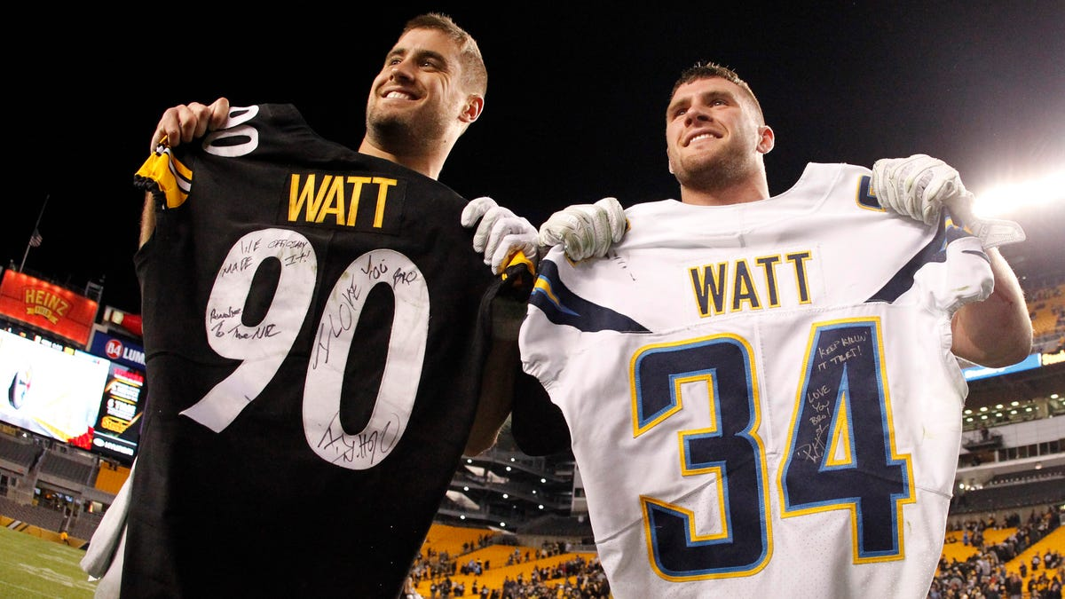 Dec 2, 2018; Pittsburgh, PA, USA;  Brothers Los Angeles Chargers fullback Derek Watt (L) and Pittsburgh Steelers outside linebacker T.J. Watt (R) exchange jerseys after their game against at Heinz Field. The Chargers won 33-30. Mandatory Credit: Charles LeClaire-USA TODAY Sports