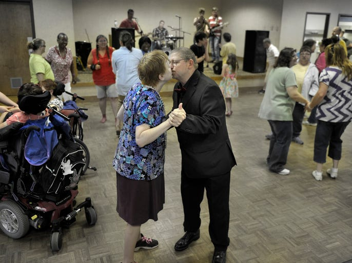 Coy and Rosemary Maness dance to 'When You Say Nothing at All,' sung in honor of their one-year wedding anniversary.
