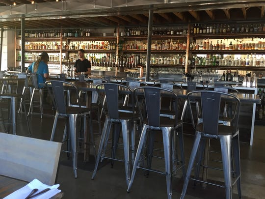The dining room in the new Midtown Eats combines industrial chic with a sleek rusticity.