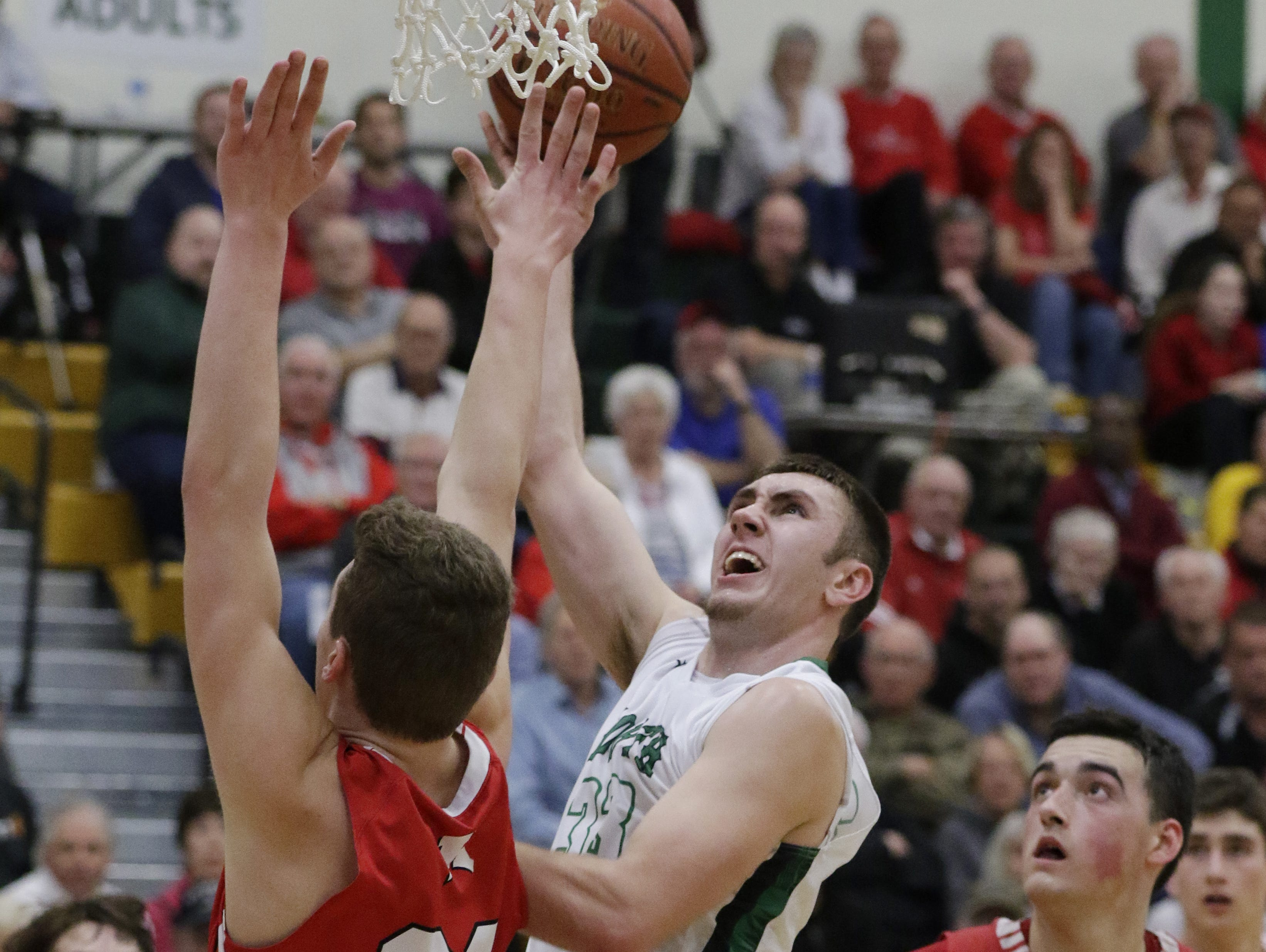 Oshkosh North's Philip Flory puts up a shot over Kimberly's Levi Nienhaus-Borchert in the second half on Tuesday.