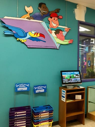 Murals at Linebaugh Library painted by artist Norris Hall will be painted over in a new remodeling project.