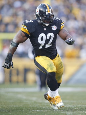 Dec 21, 2014; Pittsburgh, PA, USA; Pittsburgh Steelers outside linebacker James Harrison (92) rushes the line of scrimmage against the Kansas City Chiefs during the fourth quarter at Heinz Field. The Steelers won 20-12.