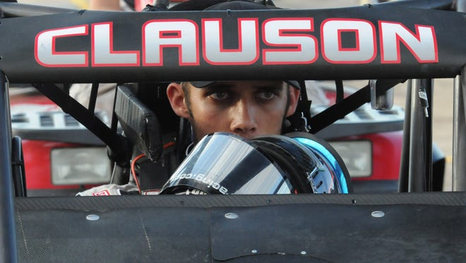 FILE -- Noblesville's Bryan Clauson  waits in the car before the feature Thursday, July 26,  2012 at Lucas Oil Raceway. Greg Griffo