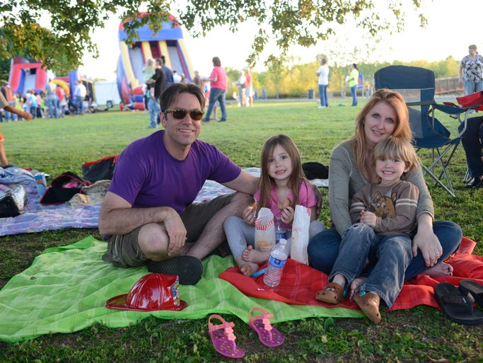 Jesse, Sophie, Kirsten and Jackson Benfield spend time together during the Family Movie Night at Memorial Park in Hendersonville on  April 25.