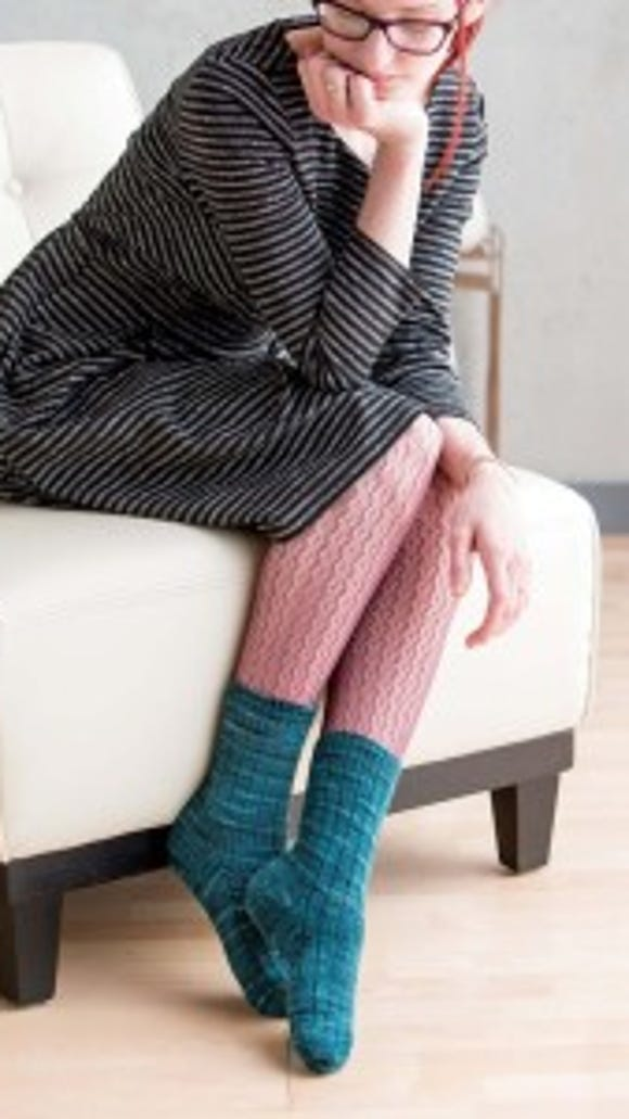 These basic ribbed socks have wide ribs of knitted stitches and narrow columns of purl ribs.  Kate recommends these for variegated yarn.
