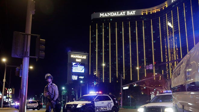 Police officers stand along the Las Vegas Strip near the Mandalay Bay on Oct. 1, 2017.