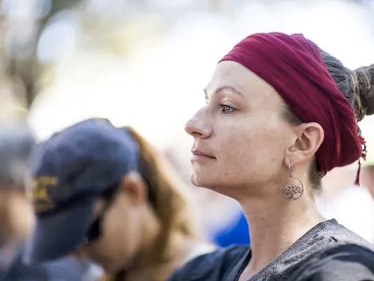 Sabrina Lartz of Fort Myers listen to speakers in Cambier