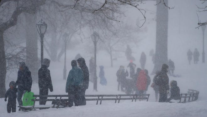 In this Jan. 23, 2016, file photo, despite adverse weather conditions, people visit New York's Central Park as a large winter storm enveloped the East Coast. The blizzard has set another record, in New York City, the National Weather Service said Thursday, April 28, 2016, in a report prompted by questions about the accuracy of snowfall measurements.