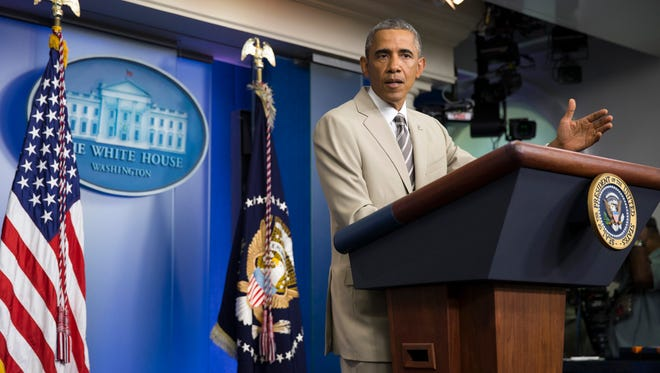 President Barack Obama spoke to the press on Thursday before convening a meeting with his national security team on the militant threat in Syria and Iraq. U.S. operations in Iraq have cost more than $560 million so far, the Pentagon says.