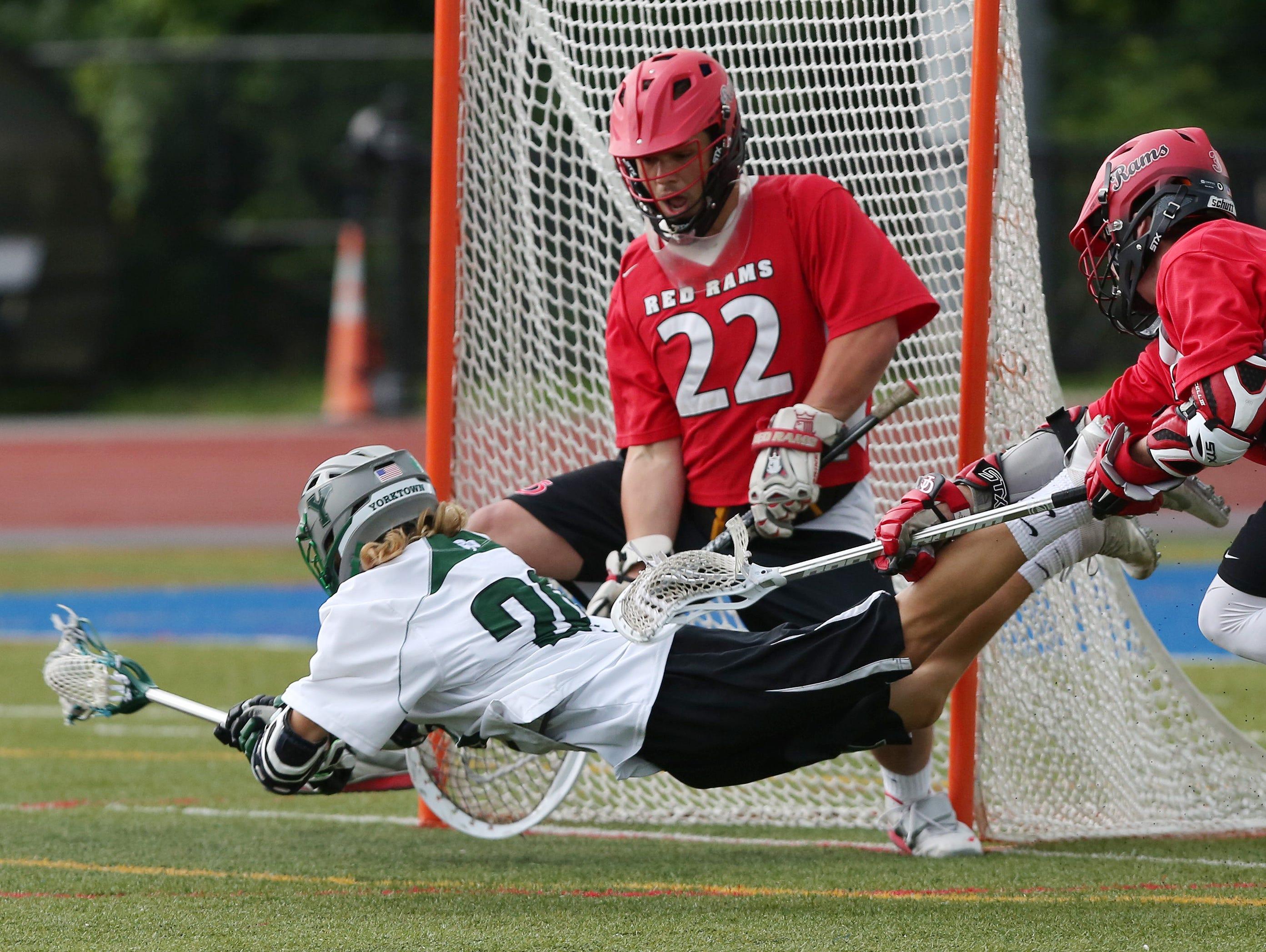 Jamesville-Dewitt goalie Dylan Fleischmann (22) stops a shot from Yorktown's Shane Dahlke (29) during the NYSPHSAA Class B championship lacrosse game at Middletown High School June 11, 2016. Jamesville-Dewitt won the game 9-6.