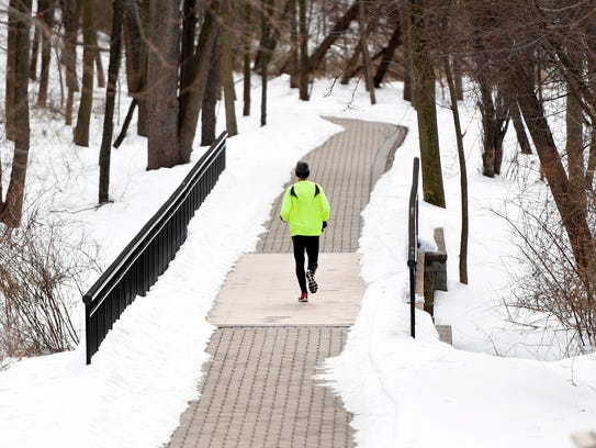 A jogger travels down the path connecting Westwood