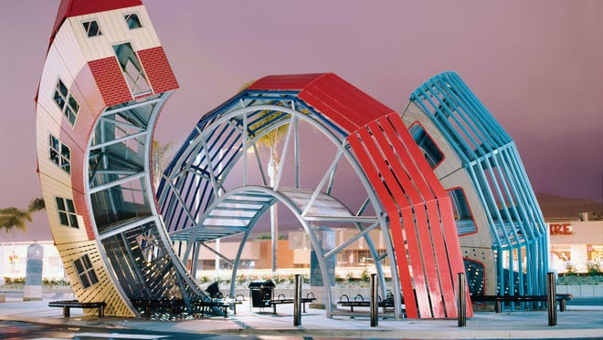 """Dennis Oppenheim's """"Bus Home,"""" a steel, acrylic and plastic structure, """"rises from the earth in three curving canopies."""""""