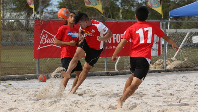 Strykers FC's Dominic Gadia attempts to score a goal off a header against Doosan FC in an opening week match of the Land Shark Beach Soccer League Sunday at the Guam Football Association National Training Center beach soccer court. The Strykers won 7-6.