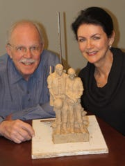 Garland Weeks, left, is creating an 11-feet tall bronze sculpture to honor Vietnam veterans. The sculpture is being commissioned by the Major Francis Grice Chapter of the Daughters of the American Revolution. The organization is represented by local artist and chapter member Shirley King, right.