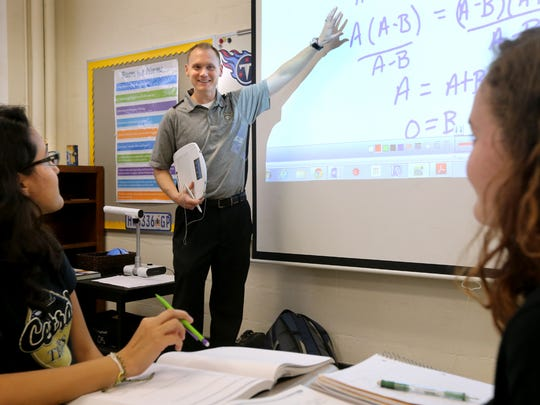 Central Magnet School math teacher Kyle Prince, who was named the top educator in Middle Tennessee during the state's Teacher of the Year awards on Thursday night,  teaches an Algebra 2 class, on Friday, Sept. 25, 2015. Maria Rodriguez, left, and Emily Jordan, right listen as Prince teaches.