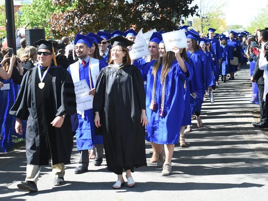 Candidates for graduation walk in for SUNY New Paltz's