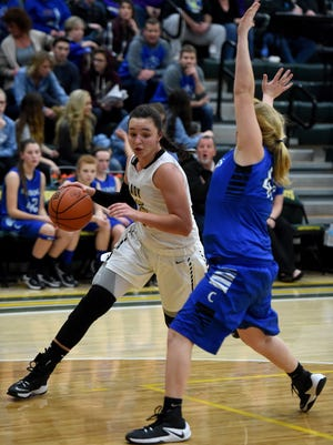 Winchester's Maddie Lawrence drives the ball around Centerville's Cassidy Weiss Tuesday, Jan. 31, 2017, in the basketball sectional at Northeastern in Fountain City.