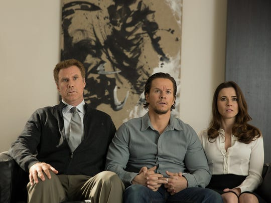 """This photo provided by Paramount Pictures shows, Will Ferrell, from left, as Brad Whitaker, Mark Wahlberg as Dusty Mayron and Linda Cardellini as Sara, in the film, """"Daddy's Home,"""" from Paramount Pictures and Red Granite Pictures. (Patti Peret/Paramount Pictures via AP)"""