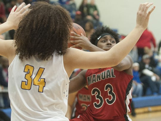 Male Lady Bulldogs center Cameron Browning defends