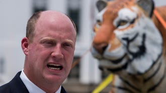 Lt. Gov. candidate Will Ainsworth holds a news conference at the State Capitol on Monday July 16, 2018 with a fiberglass tiger and a boat in response to campaign attacks by his opponent Twinkle Cavanaugh.