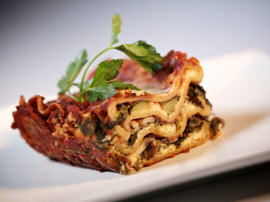 Vegetable Lasagna made with whole wheat lasagna noodles, spinach, mushrooms, onions and cheese.