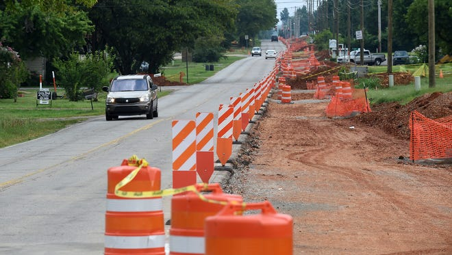 In this file photo, vehicles travel on South College St. near Pinkston Middle School on Aug. 5, 2015. A project to widen the street to three lanes is underway.