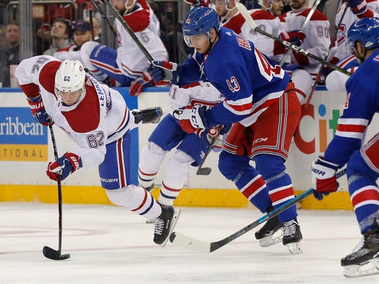 Montreal Canadiens left wing Artturi Lehkonen (62) makes an off-balance pass against New York Rangers defenseman Libor Hajek (43) during the first period of an NHL hockey game, Friday, March 1, 2019, in New York. (AP Photo/Julie Jacobson)