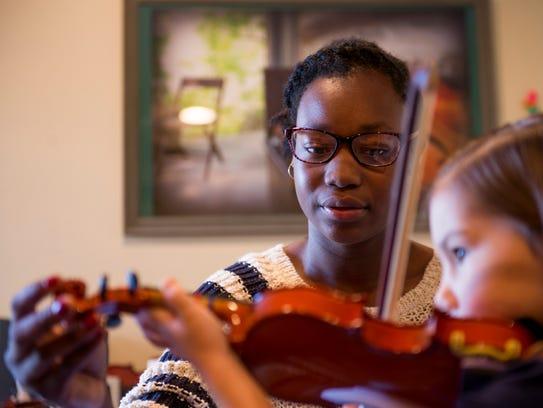 Alyssa Compton, 15, helps her younger sister Sophia,