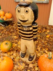 A Brutus Buckeye statue carved by Ron McLaughlin is displayed at Pigeon Roost Farms.