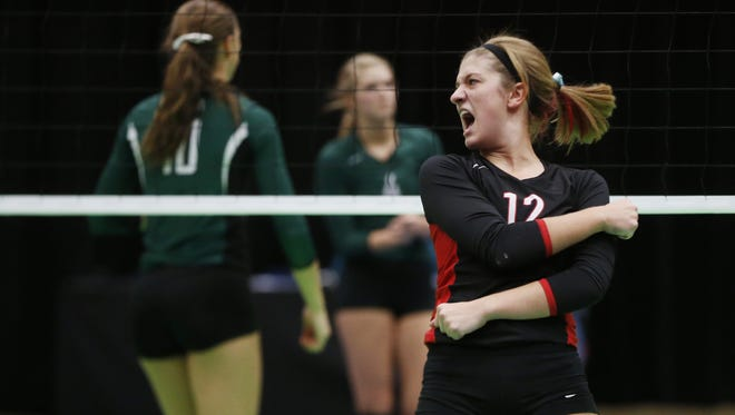Harlan's Jessica DuVal (12) celebrates a point against Pella Tuesday, Nov. 10, 2015 during the state volleyball tournament in Cedar Rapids.