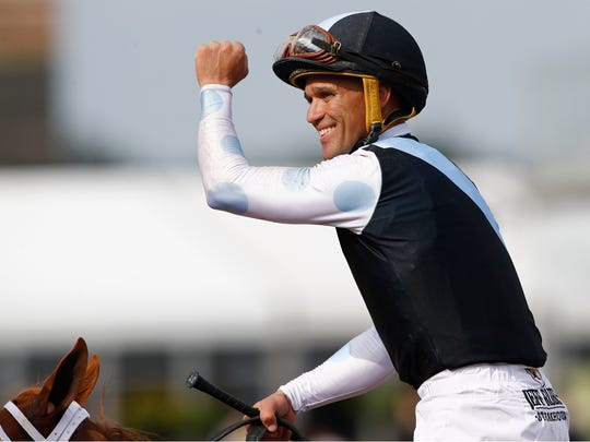 Point of Honor with Javier Castellano aboard celebrate after winning the Black Eyed Susan horse race at Pimlico Race Course, Friday, May 17, 2019, in Baltimore. Ulele with Joel Rosario atop finishes second with Cookie Dough with Irad Ortiz Jr. onboard places third. (AP Photo/Patrick Semansky)