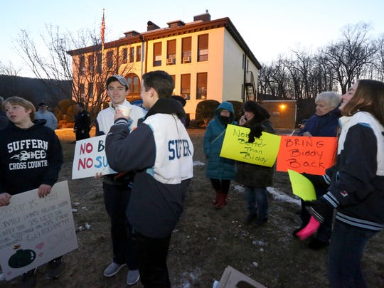 People begin to gather to protest the removal of Suffern High School cross country coach Joe Biddy before a school board meeting on Tuesday.