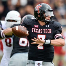 LUBBOCK, TX - SEPTEMBER 13: Davis Webb #7 of the Texas Tech Red Raiders looks to pass the ball during game action against the Arkansas Razorbacks on September 13, 2014 at Jones AT&T Stadium in Lubbock, Texas. Arkansas defeated Texas Tech 49-28. (Photo by John Weast/Getty Images)